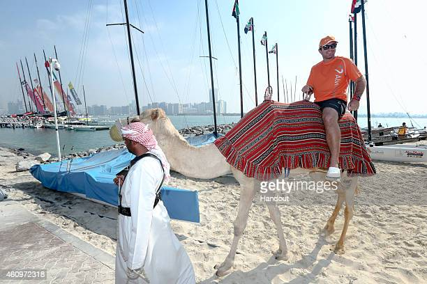 In this handout image provided by the Volvo Ocean Race The teams parade through the Destination village on camels to the boats before the Abu Dhabi...