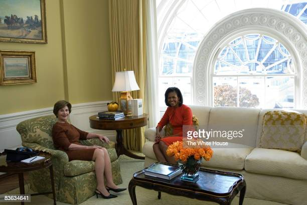 In this handout image provided by the White House, First Lady Laura Bush meets with U.S. President-elect Barack Obama's wife Michelle Obama in the...