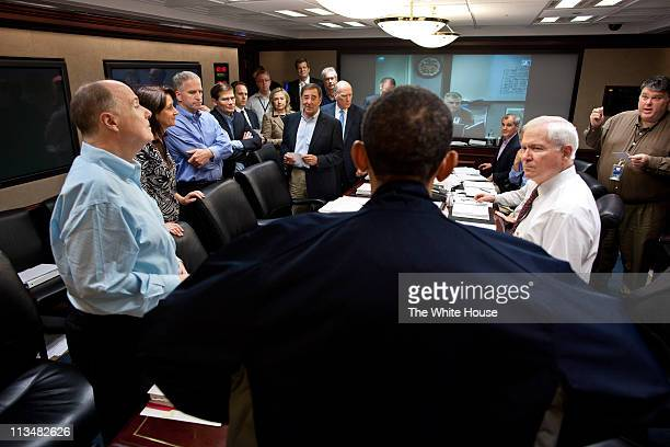 In this handout image provided by The White House, President Barack Obama talks with members of the national security team at the conclusion of one...