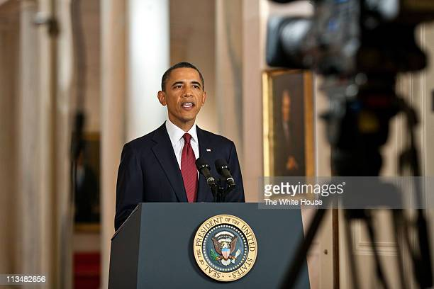 In this handout image provided by The White House, President Barack Obama delivers a statement in the East Room of the White House on the mission...