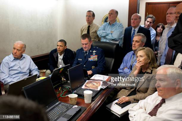 In this handout image provided by The White House, President Barack Obama, Vice President Joe Biden, Secretary of State Hillary Clinton and members...