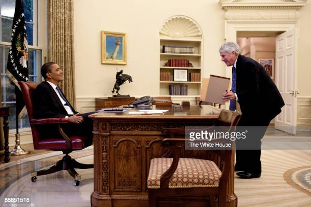 In this handout image provided by The White House President Barack Obama speaks with White House Counsel Gregory Craig in the Oval Office June 11...