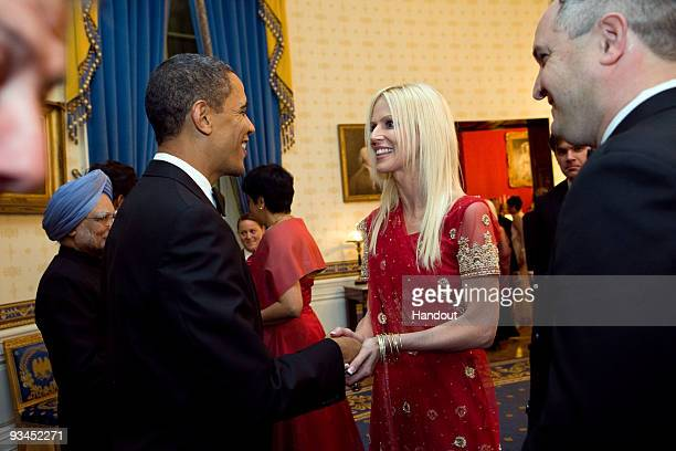 In this handout image provided by The White House President Barack Obama greets Michaele Salahi and Tareq Salahi at a State Dinner in the State...