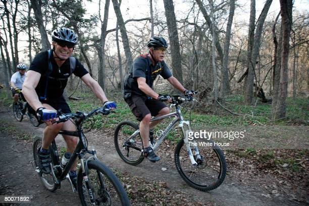 In this handout image provided by the White House President George W Bush and Prime Minister Anders Fogh Rasmussen of Denmark ride bikes together at...