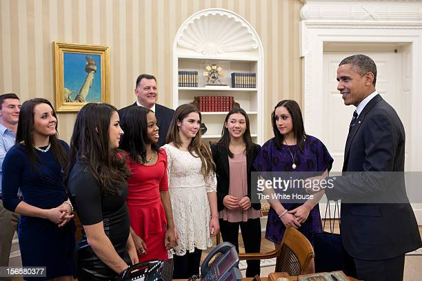In this handout image provided by The White House US President Barack Obama talks with members of the 2012 US Olympic gymnastics teams Steven...