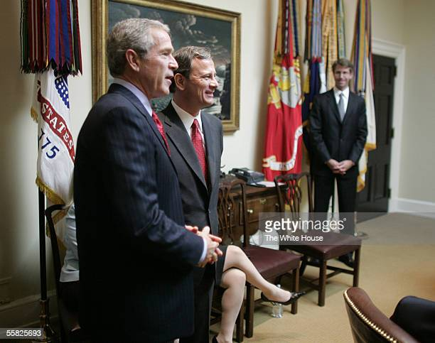 In this handout image provided by the White House, U.S. President George W. Bush stands with Judge John Roberts in the Roosevelt Room of the White...