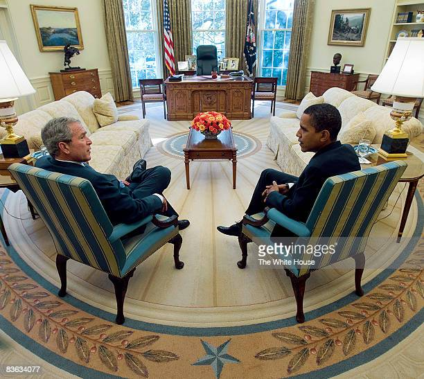 In this handout image provided by the White House US President George W Bush meets with US Presidentelect Barack Obama in the Oval Office of the...