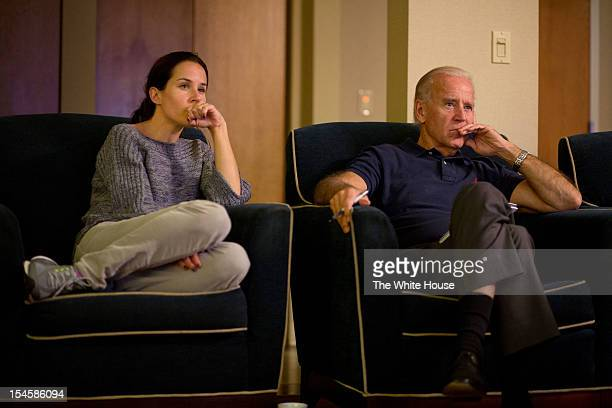 In this handout image provided by The White House US Vice President Joe Biden and his daughter Ashley Biden watch the third presidential debate on...