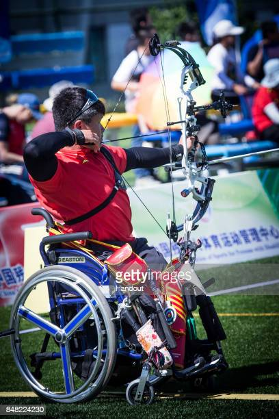 In this handout image provided by the World Archery Federation Ai Xinliang shoots during the compound men open finals during the 2017 World Archery...