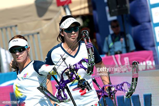 In this handout image provided by the World Archery Federation, Colombia in the compound womens team bronze final at the Archery World Cup 2014 Stage...