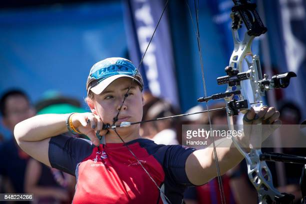 In this handout image provided by the World Archery Federation Phoebe Pine of Great Britain shoots during the compound mixed team open finals during...