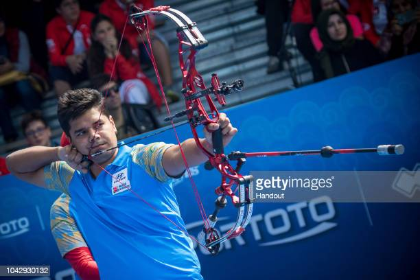 In this handout image provided by the World Archery Federation Abhishek Verma of India during the Men's compound finals during the Hyundai Archery...
