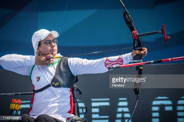 In this handout image provided by the World Archery Federation ZAhhra Nemati of Iran during the Women's Recurve team finals during the Shanghai 2019...