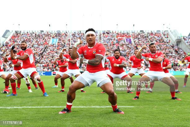 In this handout image provided by the World Rugby, Tonga players perform the Sipi Tau prior to the Rugby World Cup 2019 Group C game between...