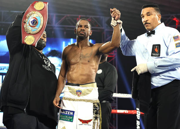In this handout image provided by Top Rank, Jamel Herring celebrates defeating Jonathan Oquendo during a Jr. Lightweight WBO World Title bout at MGM...