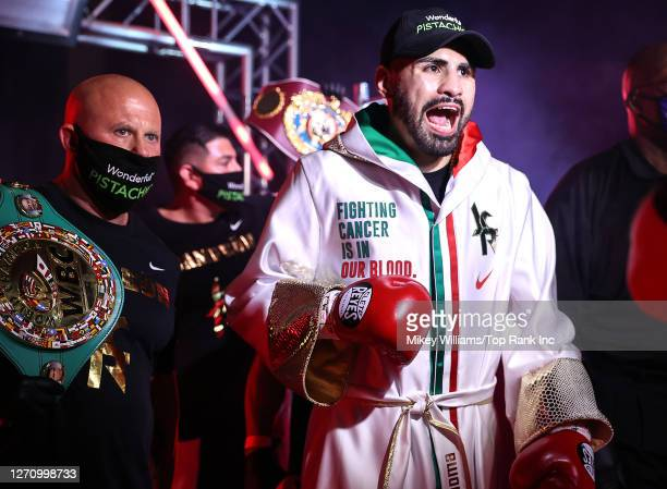 In this handout image provided by Top Rank, Jose Ramirez walks to the ring before facing Viktor Postol in a Jr. Welterweight WBC/WBO World Title Bout...