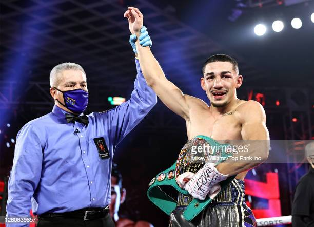 In this handout image provided by Top Rank, Teofimo Lopez Jr celebrates after defeating Vasiliy Lomachenko in their Lightweight World Title bout at...