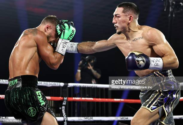 In this handout image provided by Top Rank, Teofimo Lopez Jr punches Vasiliy Lomachenko in their Lightweight World Title bout at MGM Grand Las Vegas...