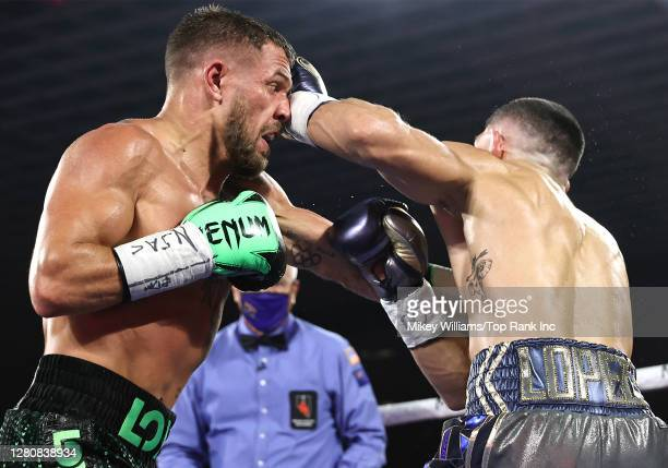 In this handout image provided by Top Rank, Vasiliy Lomachenko fights Teofimo Lopez Jr in their Lightweight World Title bout at MGM Grand Las Vegas...