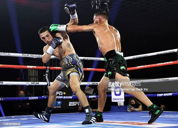 In this handout image provided by Top Rank, Vasiliy Lomachenko punches Teofimo Lopez Jr in their Lightweight World Title bout at MGM Grand Las Vegas...