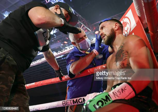 In this handout image provided by Top Rank, Vasiliy Lomachenko sits in his corner during the Lightweight World Title bout against Teofimo Lopez Jr at...