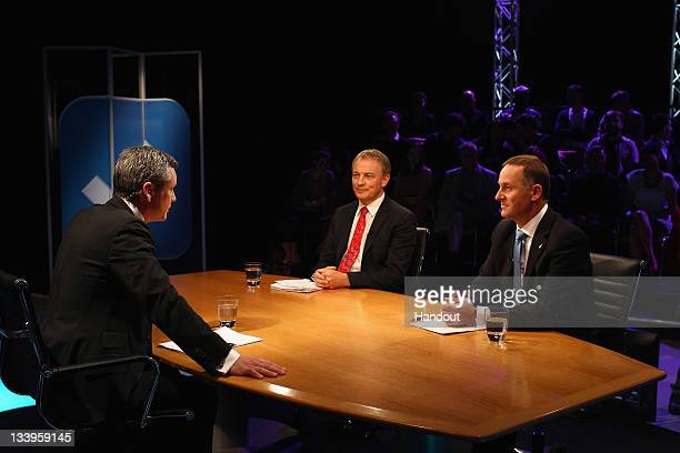 In this handout image provided by TVNZ, National Party Leader John Key and Labour Party Leader Phil Goff debate issues with Guyon Espiner during the...
