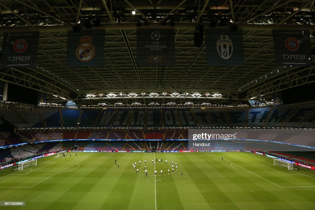 In this handout image provided by UEFA, a general view as Juventus players warm up during a training session prior to the UEFA Champions League Final between Juventus and Real Madrid at the National Stadium of Wales on June 2, 2017 in Cardiff, Wales.