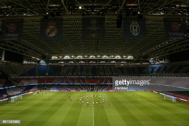 In this handout image provided by UEFA a general view as Juventus players warm up during a training session prior to the UEFA Champions League Final...