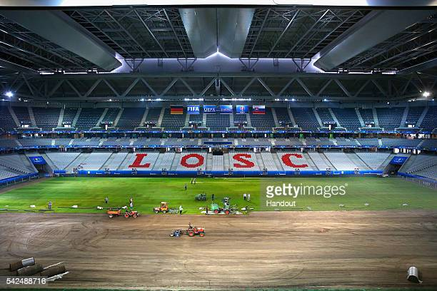 In this handout image provided by UEFA A general view as the pitch is replaced during the UEFA EURO 2016 at Stade Pierre Mauroy on June 23 2016 in...