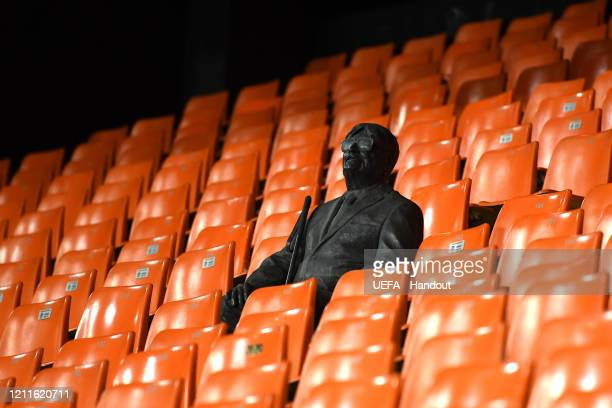 In this handout image provided by UEFA A statue representing a former fan is seen in the stands as he is honored by his club after he passed away two...
