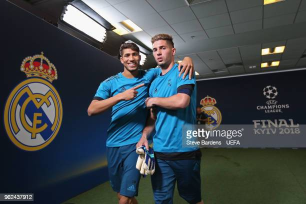 In this handout image provided by UEFA Achraf Hakimi and Luca Fernndez of Real Madrid walk down the tunnel during a training session ahead of the...