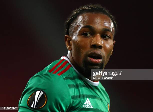 In this handout image provided by UEFA, Adama Traore of Wolverhampton Wanderers reacts during the UEFA Europa League round of 16 first leg match...