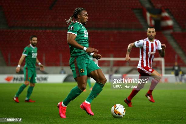 In this handout image provided by UEFA Adama Traore of Wolverhampton Wanderers in action during the UEFA Europa League round of 16 first leg match...