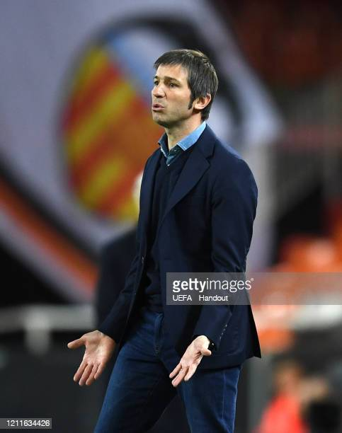 In this handout image provided by UEFA Albert Celades head coach of Valencia reacts during the UEFA Champions League round of 16 second leg match...