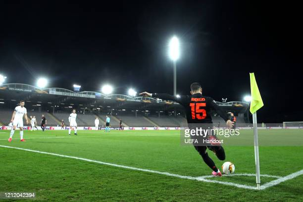 In this handout image provided by UEFA Andreas Pereira of Manchester United takes a corner kick during the UEFA Europa League round of 16 first leg...
