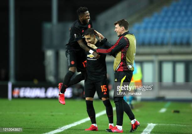 In this handout image provided by UEFA, Andreas Pereira of Manchester United celebrates after scoring his team's fourth goal with Fred and Victor...