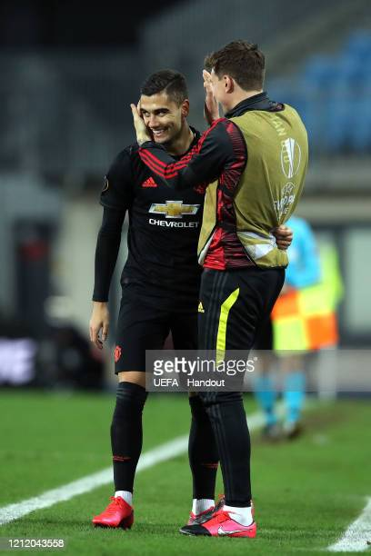 In this handout image provided by UEFA Andreas Pereira of Manchester United celebrates after scoring his team's fourth goal with Victor Lindelof...