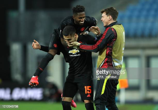 In this handout image provided by UEFA Andreas Pereira of Manchester United celebrates after scoring his team's fourth goal with Fred and Victor...
