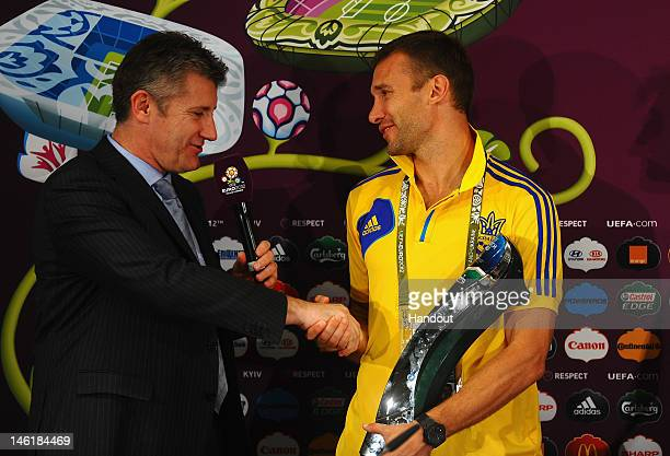 In this handout image provided by UEFA, Andriy Shevchenko of Ukraine receives the 'Carlsberg Man of the Match' award as speaks with the media during...