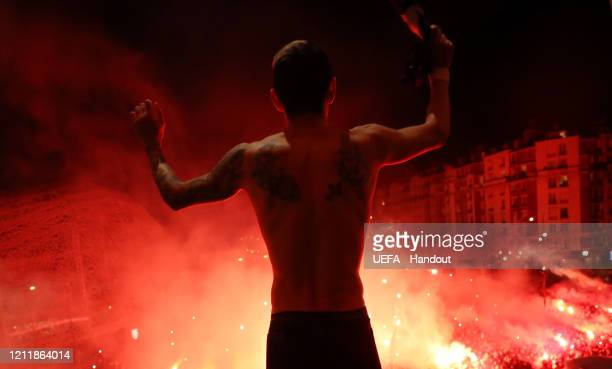 In this handout image provided by UEFA Angel Di Maria of Paris SaintGermain celebrates victory with fans outside the stadium after the UEFA Champions...
