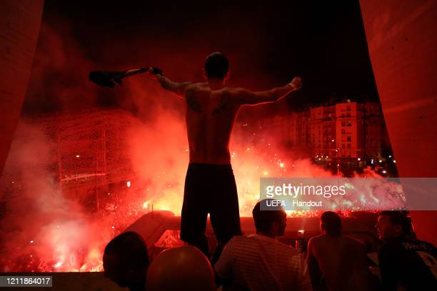 In this handout image provided by UEFA, Angel Di Maria of Paris Saint-Germain celebrates victory with fans outside the stadium after the UEFA...