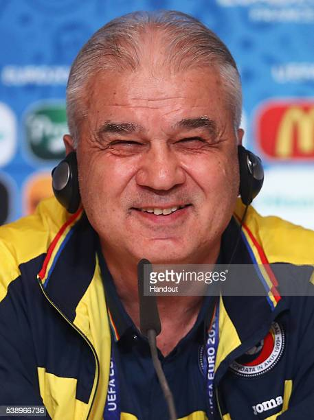 In this handout image provided by UEFA, Anghel Iordanescu, coach of Romania talks during a press conference on June 9, 2016 in Saint-Denis, France.