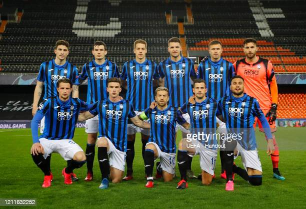 In this handout image provided by UEFA Atalanta pose for a team photo during the UEFA Champions League round of 16 second leg match between Valencia...