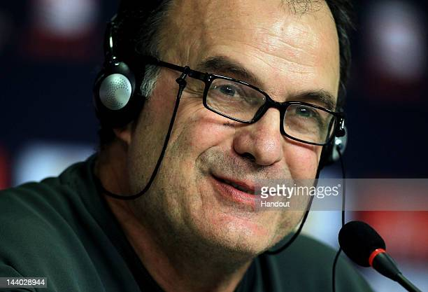 In this handout image provided by UEFA Athletic Bilbao coach Marcelo Bielsa talks to the media during the Athletic Bilbao press conference ahead of...
