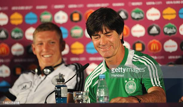 In this handout image provided by UEFA Bastien Schweinsteiger and coach Joachim Low of Germany during a UEFA EURO 2012 press conference at the...