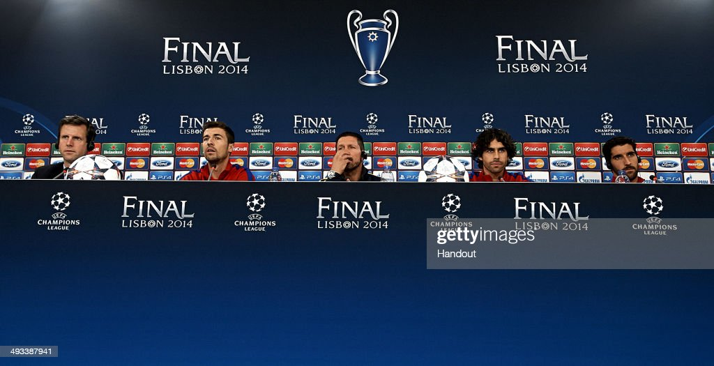 In this handout image provided by UEFA, (L-R) Captain Gabi, coach Diego Simeone, Tiago and Raul Garcia of Club Atletico de Madrid attend a press conference ahead of the UEFA Champions League final against Real Madrid at Estadio da Luz on May 23, 2014 in Lisbon, Portugal.