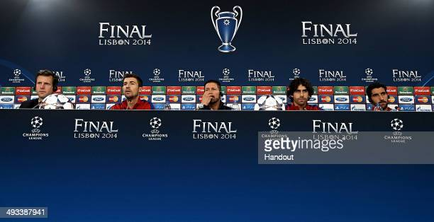 In this handout image provided by UEFA Captain Gabi coach Diego Simeone Tiago and Raul Garcia of Club Atletico de Madrid attend a press conference...