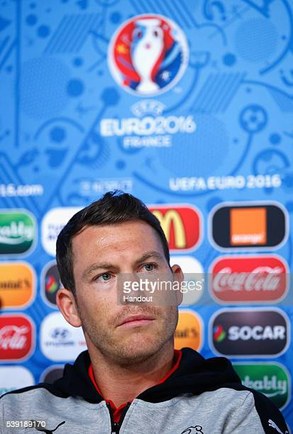 In this handout image provided by UEFA Captain Stephan Lichtsteiner of Switzerland talks to the media during the Switzerland Press Conference at the...