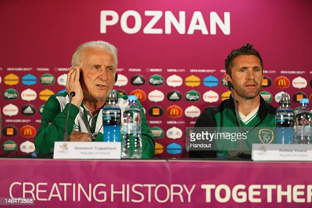 In this handout image provided by UEFA, Coach Giovanni Trapattoni and Robbie Keane of Republic of Ireland talk to the media during a UEFA EURO 2012...