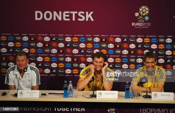 In this handout image provided by UEFA Coach Oleh Blokhin Andriy Pyatov and Marco Devic of Ukraine attend a UEFA EURO 2012 press conference at the...